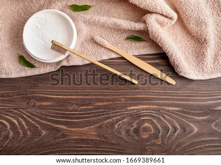 Wooden toothbrushes, dentifrice and bath towel on wooden backround Photo stock ©
