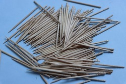 Wooden toothpicks isolated on sky blue background