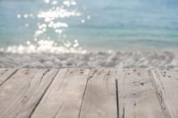 Wooden top table bokeh sea