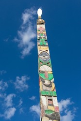Wooden totem against blue sky at Janis club at the seaside, Vama Veche, Romania