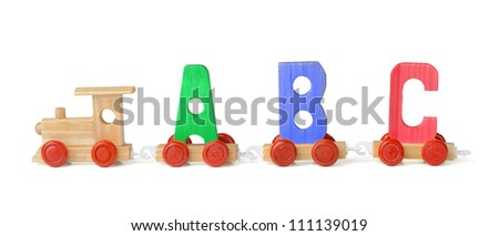 Wooden toy ABC train isolated on white - stock photo