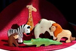 Wooden toy. African animals: giraffe, lion, zebra, crocodile, monkey, elephant.