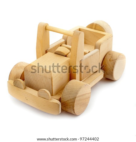 Wooden toy car on white background