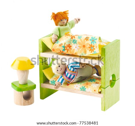 Wooden toy dolls in the bedroom an image isolated on white
