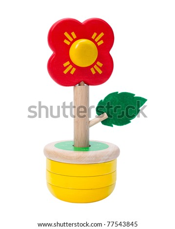 Wooden toy flower, children create by joining pieces of wooden color, an image isolated on white