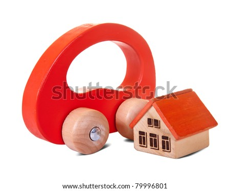 Wooden  toy house and car on white background
