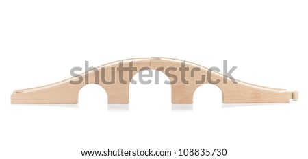 Wooden toy railway bridge. Isolated on white background