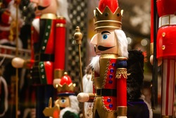 Wooden toy soldier Nutcracker in a red suit on the shop window.Buying gifts and Souvenirs for the holiday.Happy New Year!Merry Christmas!Christmas shopping.