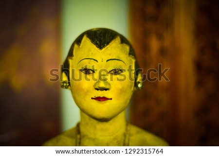 Wooden toy statue of woman wife with traditional asian hair style waiting in the wedding reception for local custom and culture