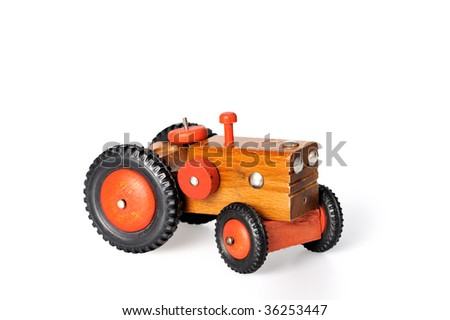wooden tractor toy on a white background