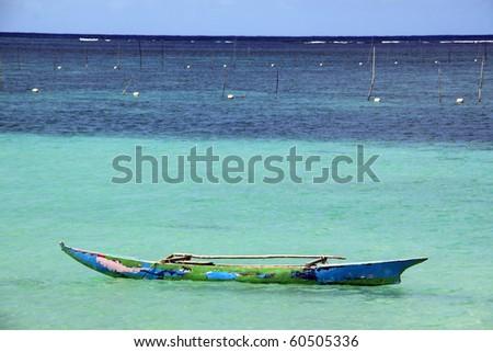 Wooden traditional boat on the water near Upolu island, Samoa