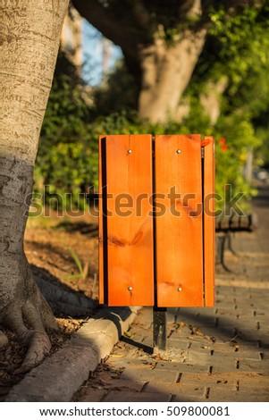 Wooden trash bin outdoors. #509800081