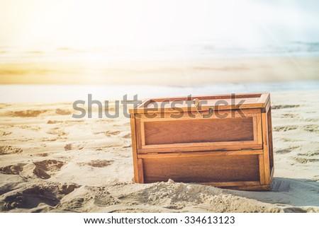 Wooden Treasure Box On The Beach With Sun Beam