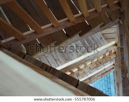 Wooden Triangular Staircase In A Tower Interior