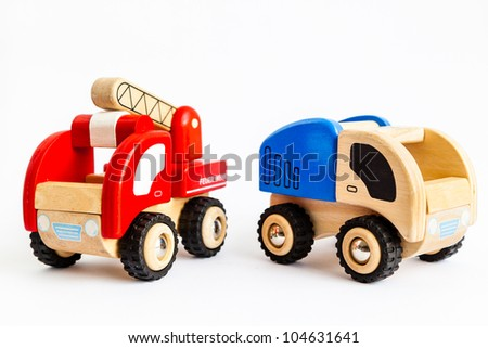 Wooden truck and fire engine isolated on white