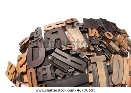 Wooden typescript letters against a white background - stock photo