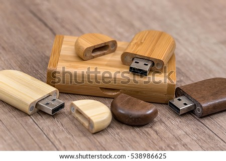 wooden usb flash drive on desk #538986625