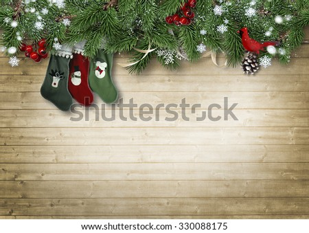 Wooden vintage background with fir branches and Christmas Sock. Christmas background with space for photo or text