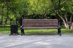 Wooden vintage bench in a public Park.