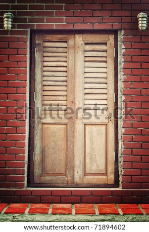 wooden vintage door on red brick