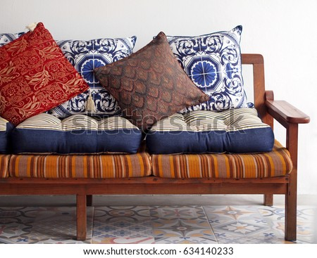 wooden vintage sofa with asian...