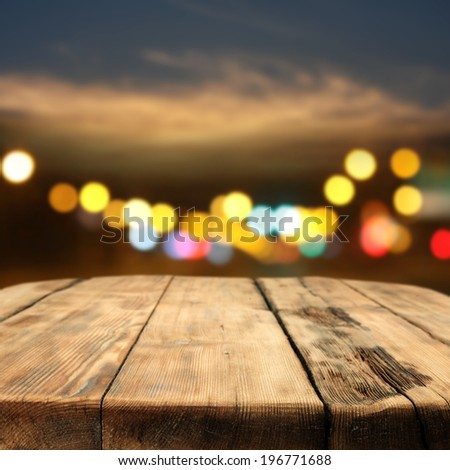 wooden vintage table night sky and lights
