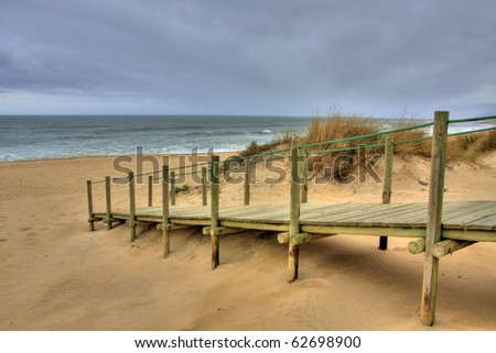 Wooden walk way over sand dune giving access to the beach, Esposende, Portugal (HDR photo)