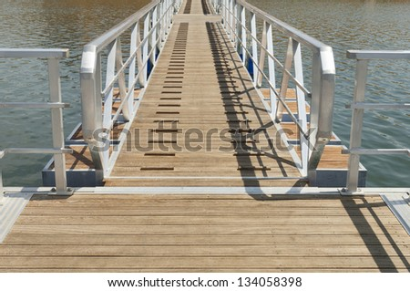 Wooden walkway serving Amieira pier on the banks of the reservoir of Alqueva, Alentejo, Portugal