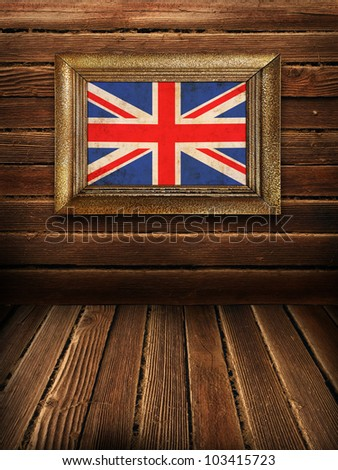 Wooden wall and floor with British framed flag, vintage background