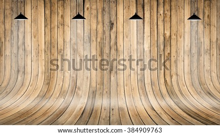 Wooden wall and floor with shining lamp on top. Background texture