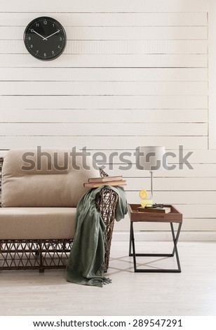wooden wall and the wicker sofa with clock #289547291