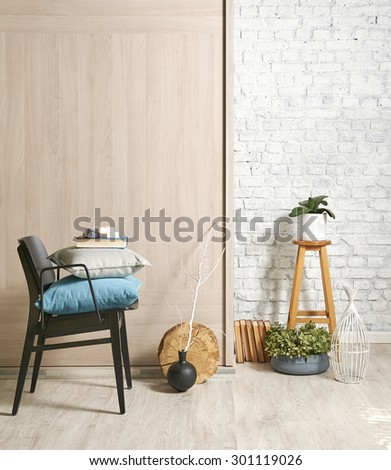 wooden wall interior with black chair and green flower