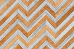 Wooden wall made of narrow planks. Wood texture background. Light parquet floor with zigzag pattern.