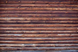 wooden wall of log house as background