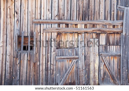 Wooden wall old country barn with a window and door