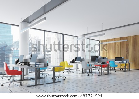 Wooden wall open space office interior with panoramic windows, columns, colored chairs and rows of tables with computer monitors on them. 3d rendering mock up #687721591