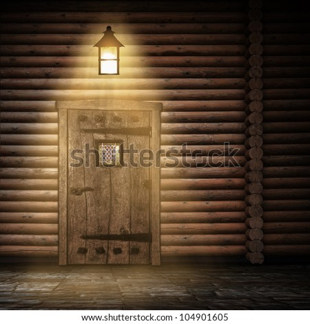 Wooden wall with door and light at night