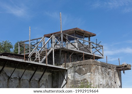 Wooden watchtower on the stony wall of the fort in Kronshtadt, Russia.