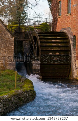 Wooden water mill in a stream