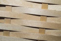 Wooden weaving background. wood wickerwork texture