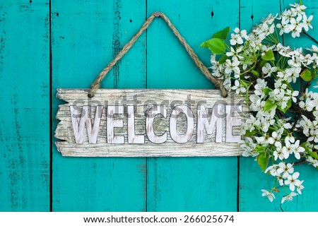 wooden welcome sign with spring ...