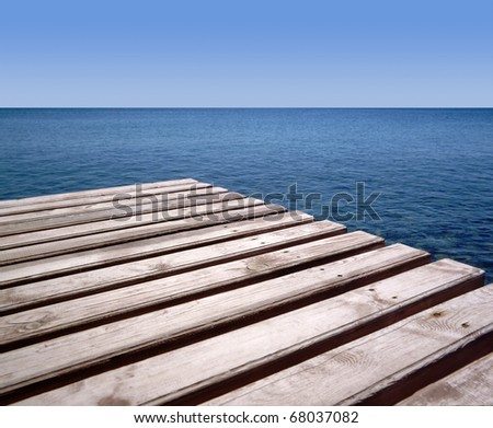 Wooden wharf and blue sea