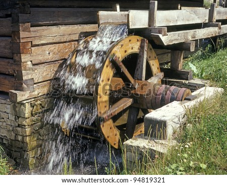 Wooden wheel of an ancient water mill in open-air museum, Skansen at Roznov pod Radhostem, Western Beskids, Czech Republic