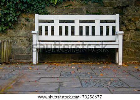 Wooden white bench in a park