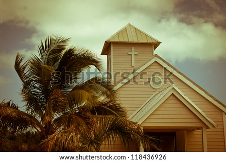 Wooden white church and palm trees, Bahamas