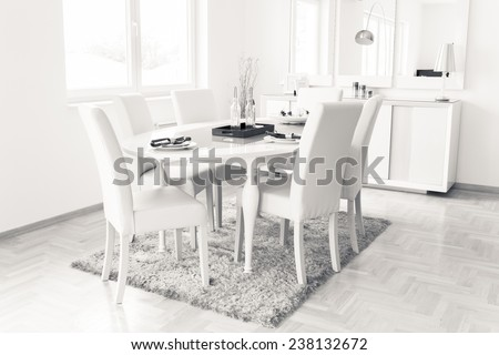 Wooden white table in dining room.Modern dining room with white furniture. Modern architecture contemporary interior, dining table and window.All white minimalist dining room.Modern design dining room