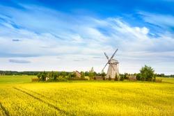 Wooden windmill on background field and sky. Dudutki village, Minsk Region, Belarus