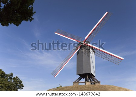 Wooden windmill on the hill in Bruges, Belgium