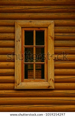 wooden window on the wall of a...