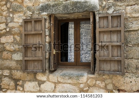 wooden window with shutters - stock photo